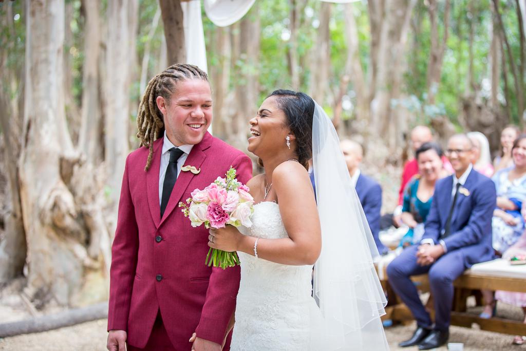 bride laughing; wedding ceremony